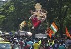Devotees carry a Ganesha idol to be installed at a 'pandal' ahead of Ganpati festival, in Mumbai on August 18, 2019. — PTI