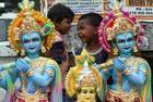 Children look on near deity of hindu god Krishna on display at a roadside ahead of Janmashtami festival in Chennai on August 22, 2019. — AFP