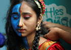A student gets her make-up done before taking part in a cultural event to mark the Hindu festival of Janmashtami inside a college in Mumbai, on August 21, 2019. — Reuters