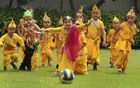Children dressed up as Lord Krishna play football during Janmashtami celebrations at a school, in Patiala on August 22, 2019. — PTI