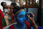 A student has her face painted before taking part in a cultural event to mark the Hindu festival of Janmashtami inside a college in Mumbai on August 21, 2019. — Reuters