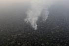Smoke billows during a fire in an area of the Amazon rainforest near Porto Velho, Rondonia State, Brazil, August 21. Reuters