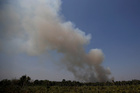Smoke billows during a fire in an area of the Amazon rainforest near Humaita, Brazil, August 14. Reuters