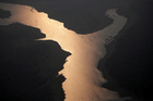 Sunlight is seen over the lake of Samuel Hydroelectric Dam in an area of the Amazon rainforest near Porto Velho, Rondonia State, Brazil, August 21. Reuters