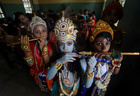 Children dressed up as Hindu Lord Krishna pose during Janmashtami festival celebrations inside a school in Agartala on August 23, 2019. — Reuters