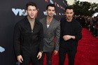 Nick Jonas, from left, Joe Jonas and Kevin Jonas, arrive at the MTV Video Music Awards at the Prudential Centre on Monday, August 26, 2019, in Newark, New Jersey. — AP/PTI
