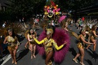 Performers in costume take part in the carnival on the main Parade day of the Notting Hill Carnival in west London on August 26, 2019. — AFP