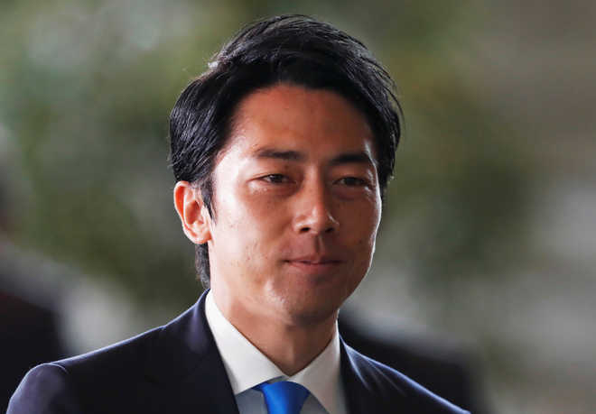 Japan's Abe drafts rising star Koizumi, allies in broad Cabinet reshuffle