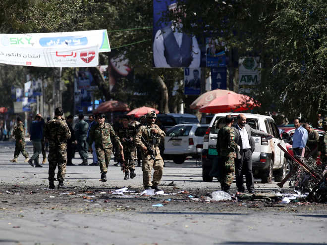 Taliban suicide bombers kill 48, Afghan President unhurt