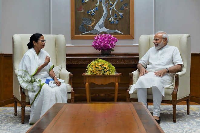 Mamata meets PM Modi; raises issue of state's renaming, invites him to Bengal