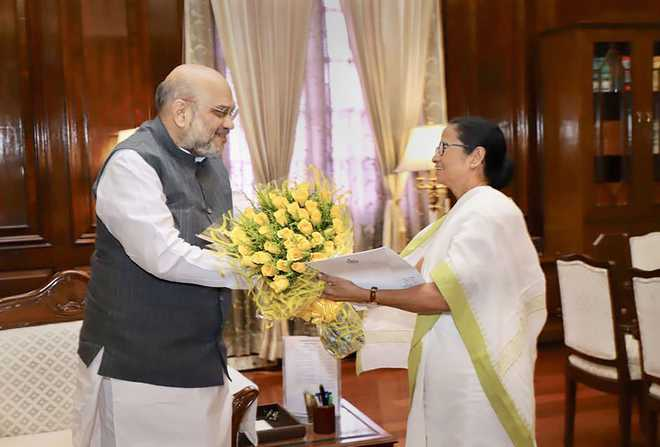 Day after meeting Modi, Mamata meets Amit Shah,  raises Assam NRC issue