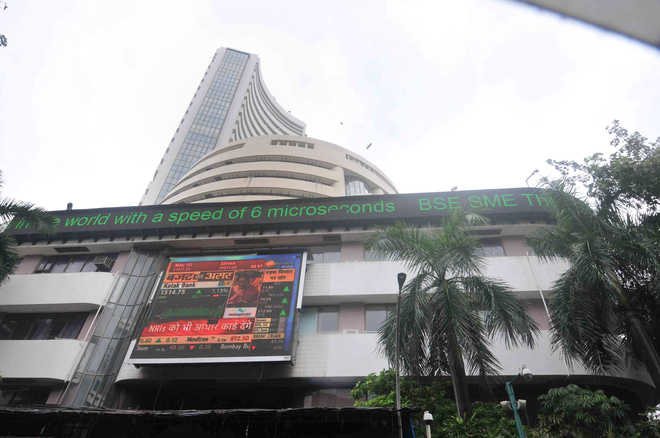 Sensex zooms over 1,900 points on FM's tax booster