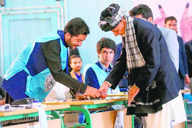 Two killed in Taliban attack as Afghans vote for President