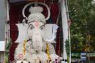 Residents gather to worship an idol of the elephant-headed Hindu deity Ganesh made of 7001 seashells for the Ganesh Chaturthi festival in Chennai on September 2, 2019. AFP photo