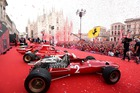 A picture shows a general view of Ferrari racing cars and Ferrari fans in Piazza Duomo in Milan on September 4, 2019 for the presentation of cars and drivers for 90th anniversary of the founding of Scuderia Ferrari. — AFP