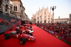 A picture shows a general view of Ferrari racing cars and Ferrari fans in Piazza Duomo in Milan on September 4, 2019. — AFP