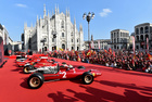 People attend an event to celebrate 90 years of Italian premium sports car maker Ferrari racing team at Milan's Duomo square, in Milan, Italy on September 4, 2019. — Reuters