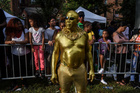 A man dressed in gold paint participates in the annual West Indies Day parade in the borough of Brooklyn in New York City on September 2, 2019. — Reuters