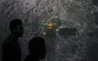 Student walk past a screen during a live streaming of Chandrayaan-2 landing at an educational institute in Mumbai, on September 7, 2019. — Reuters