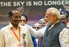 In this handout photo taken and released on September 7, 2019 by India's Press Information Bureau (PIB), Indian Prime Minister Narendra Modi (R) speaks with Indian Space Research Organisation (ISRO) chairman Kailasavadivoo Sivan at the ISRO headquarters in Bangalore. — AFP