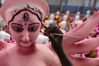 An artist works on a statue of the Hindu goddess Durga ahead of the forthcoming 'Dushhera-Vijaya Dashami' festival at a workshop in Chennai on September 18, 2019. — AFP