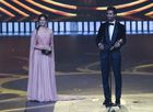 Bollywood actor Alia Bhatt and actor Vicky Kaushal reacts after receiving the Best Actor in Supporting Role - Male award during the 20th International Indian Film Academy (IIFA) Awards at NSCI Dome in Mumbai early on September 19, 2019. — AFP