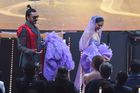 Bollywood actor Ranveer Singh carries the back of his wife and actress Deepika Padukones dress during the 20th International Indian Film Academy (IIFA) Awards at NSCI Dome in Mumbai early on September 19, 2019. — AFP