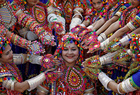 Participants dressed in traditional attire pose for pictures during rehearsals for Garba, a folk dance, in preparations for the upcoming Navratri in Ahmedabad on September 25, 2019. — Reuters