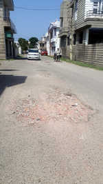 Potholes dot Shastri Nagar roads